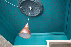 Hang a Light Fixture Without Putting a Hole in the Ceiling | The Money Pit