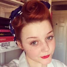 this is the hairstyle that i am sporting today inspired by the land s in the 1940 s i have two victory rolls at the front of my head