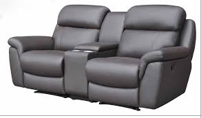 home theater chairs. snug, with adjustable padded headrests, deep thick plush seats and large armrests a cupholder buttons. upholstery made from black calfskin. home theater chairs r
