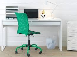 white ikea micke computer workstation desk with a green chair