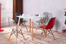 dining table and clear eiffel chairs retro