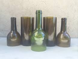 wine bottle 2 glass cutter can be found at michaels 3 candle 4 lighter 5 bucket of ice water 6 sand paper 7 protective goggles