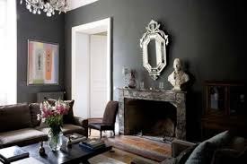 Dark rooms in muddy Victorian brown, eggplant and green are colors to use  for maximum drama.