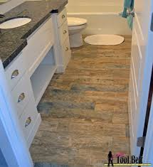 laying tile in bathroom. Step By Tutorial Showing How To Install Faux Barn Wood Tiles. This Tile Looks Laying In Bathroom