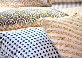 above once the fabric is printed with diffe vegetable dyes to achieve a desired color and the pattern it is washed by hand in a river steamed