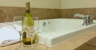 romantic georgia spa tub suite with champagne