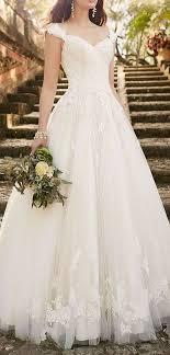 wedding dress with chandelier earrings