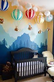 A simple, whitewashed design showcases this neutral nursery's rich wood floors and beamed ceilings, creating a natural balance of dark and light. Oliver S Whimsical Woodland Nursery Project Nursery Baby Room Woodland Nursery Boy Nursery Room