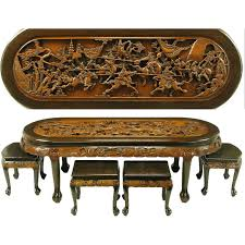 chinese oval coffee table with hand carved battle scene