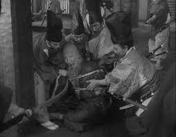 essays sansho the bailiff compassion our last view of sansho trussed up and soon to be sent into exile