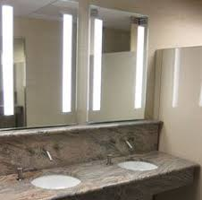 simplify your bathroom or wall with a custom lighted mirror our mirrors e copper free and use led technology to give a crisp and bright light to any
