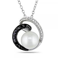 add a fashionable twist to any outfit with this freshwater pearl and black and white diamond