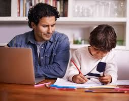 helping math teacher helping child at chalkboard stock photo  get ahead math help your child do better in math help your child do better in