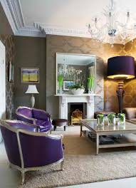 purple and gold living room living room design with gold wallpaper purple armchairs and floor ligh