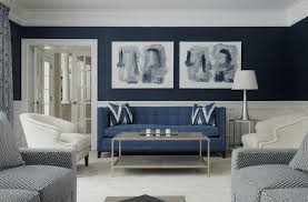 Dark blue sofa against blue walls