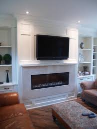white living room wall unit with built in television and gas fireplace insert combination of open shelving and lower cupboards