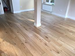 the pros and cons to having hardwood flooring in your kitchen