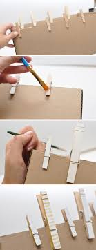 I used a small box and clipped each clothespin to the edge. Now, you can  paint away.