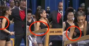 Image result for Bishop Ellis apologises to Ariana Grande for onstage 'touching' and 'joke'