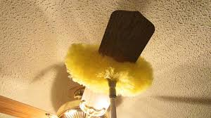 ceiling fan duster with extension pole. the estilo duster has a opening in middle that can accommodate ceiling blade up to 6 inches wide. dust sticks instead of going into fan with extension pole f
