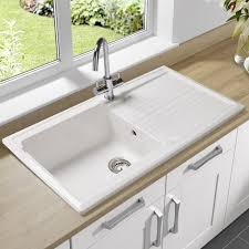 single bowl undermount sink with drain board made of porcelain in white finish
