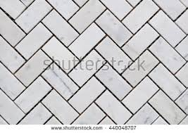 White or light grey color Stone wall texture or abstract background.  Herringbone pattern.
