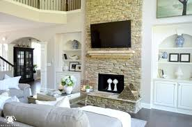 two story living room great room rock fireplace built ins summer great room built ins