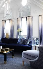 blue sofas living room: stunning living room with a blue sofa and ombre drapes by new york city interior designer