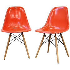 fiberglass shell chairs. pair of eames herman miller orange fiberglass dowel chairs shell l