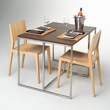 a dining table with two chairs