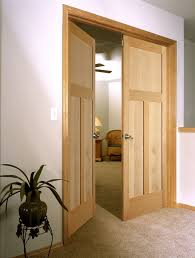 inspiring natural interior wood doors applying silver knob of entrance matched with white wall color and