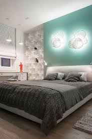 an empty wall above the bed is the perfect place to put a light fixture or two they ll brighten up the room and can add a sculptural element to it
