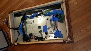 ing the monitor in the wooden frame with the double sided mirror facing outward