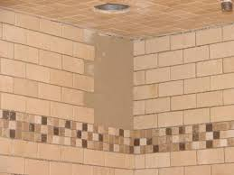 you can add a decorative mosaic border near the top of the shower walls this