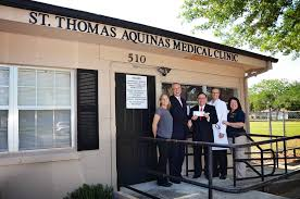 the st thomas aquinas free medical clinic in st cloud received a 5 000 grant from the million dollar round table foundation mdrt presented by mdrt