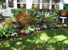 Fall Landscaping Ideas, pumpkins in the flower bed