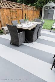 painted concrete slab and brick pavers