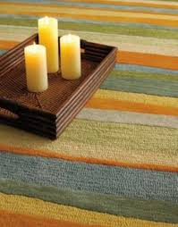 area rugs colorful striped wool sun kissed rug from company c via atticmag