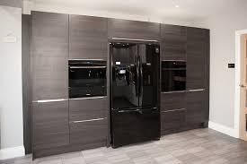 this tera oak unit houses house an american fridge freezer and ovens sourced by the home owner we provided a siemens warming drawer to complete the set up