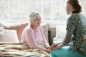 Homecare Nurse And Elderly Patient Stock Photo Dissolve