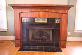 outstanding gas fireplace with brown varnishes wooden fireplace mantels and black tiled surround