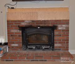 mack built a box out of s plywood and attached it to the brick using construction adhesive now the fireplace was flush and ready for stone