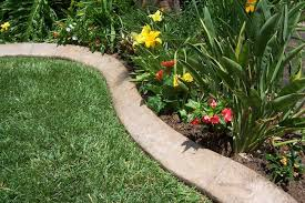 How To: Make Concrete Garden Edging Looking for an inexpensive, lasting way  to set