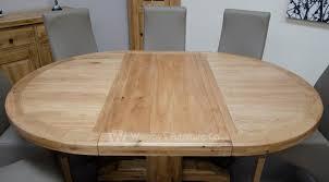buffalo oak round extending dining table 125cm dia 55cm
