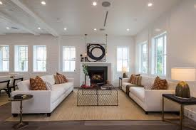 the spacious and open floor plan consists of an inviting living room and a formal dining room a family room that opens to the gourmet chefs kitchen