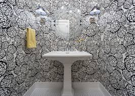 Bold Black and White Floral Wallpaper in Small Bathroom With White Pedestal  Sink