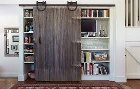 reclaimed sliding barn door for the kitchen cabinet and pantry from nat
