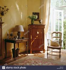 Townhouse Living Room Antique Cupboard And Console Table In Neutral Townhouse Living