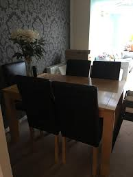 dining table and 6 chairs in great condition selling due to house move the dimensions are 90cm width and 130cm length extending to 160cm length