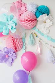 unicorn party wall decor balloons paper flowers honeycomb garlands